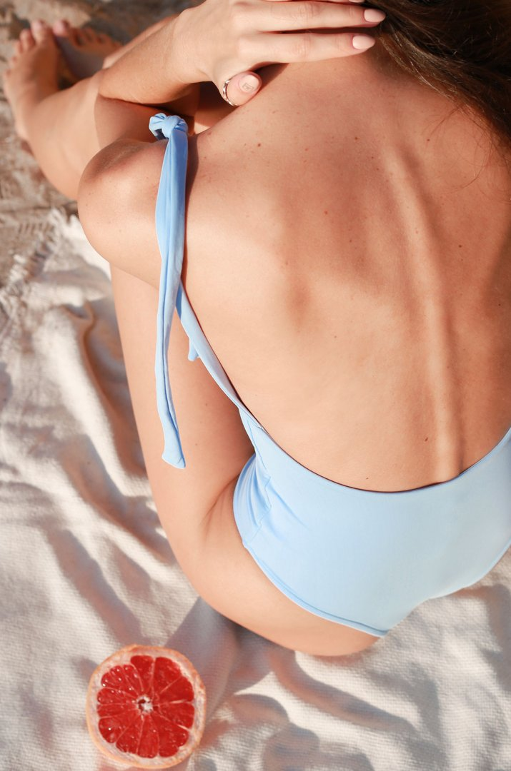 One-piece blue swimsuit with ties