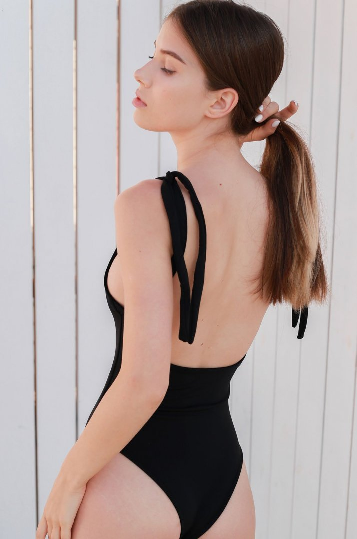 One-piece black swimsuit with ties